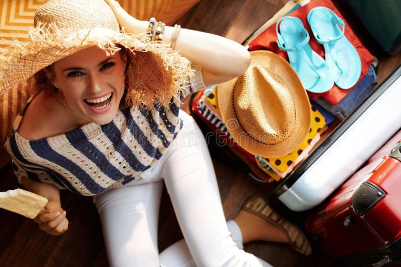 Woman with summer hat eating ice cream packing for vacation royalty free stock images