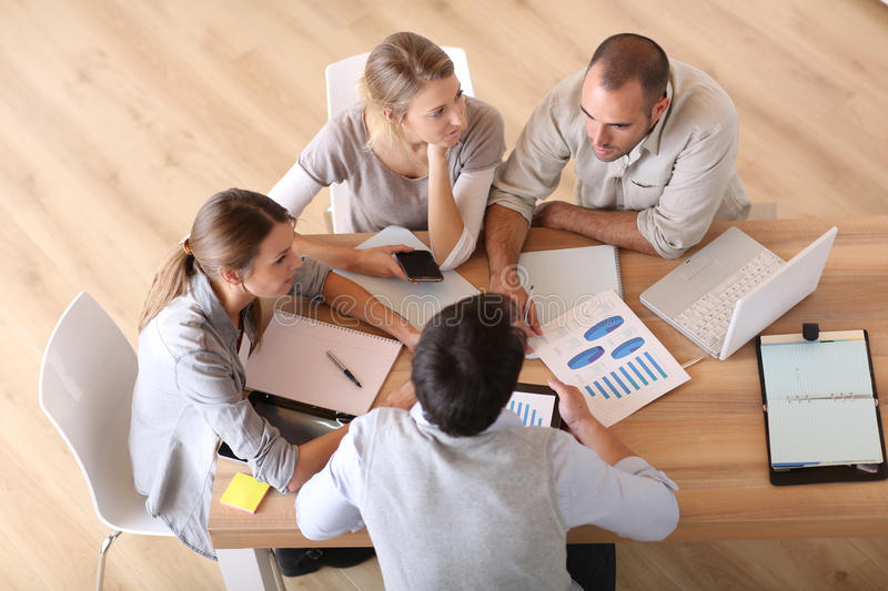 Upper view of young business team working. Upper view of business people around table royalty free stock photos