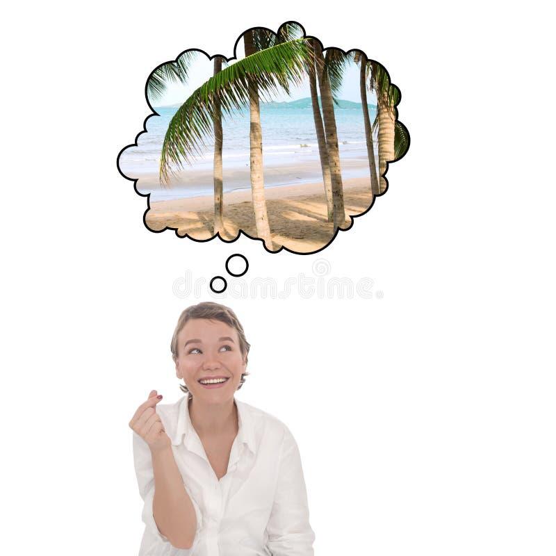 Uppfyllande av önskningar vid klick på fikon Unga kvinnor drömmer om tropisk semester Turistpratbubbla royaltyfri fotografi