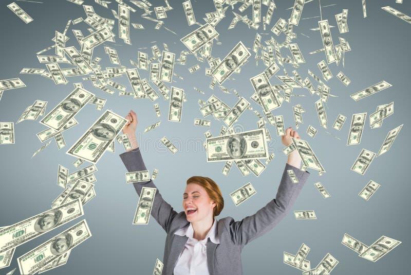 Upphetsad affärskvinna med pengarregn mot blå bakgrund arkivfoton