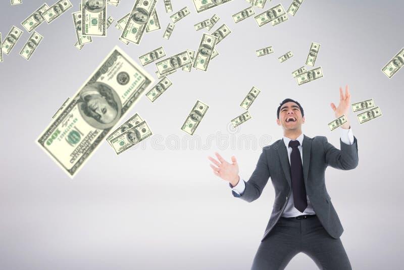 Upphetsad affärsman som ser pengarregn mot vit bakgrund royaltyfri foto
