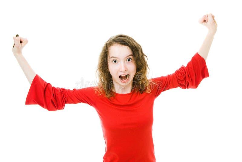 Upphetsad flicka i röd stigning upp händer royaltyfri bild
