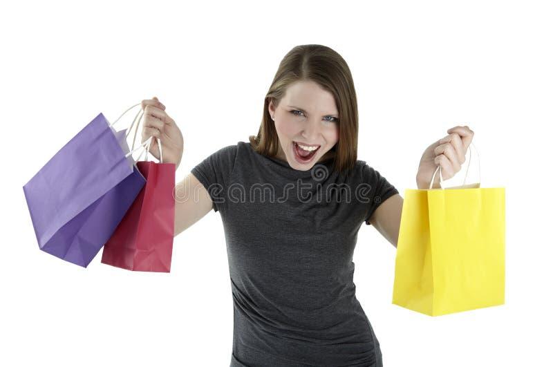Upphetsad shoppingkvinna arkivfoton