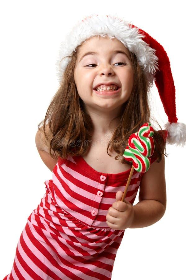 uppnosigt julflickaleende arkivbild