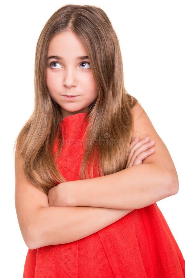 Uppriven liten flicka arkivfoto