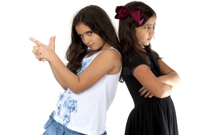 Upprivna flickor arkivfoton