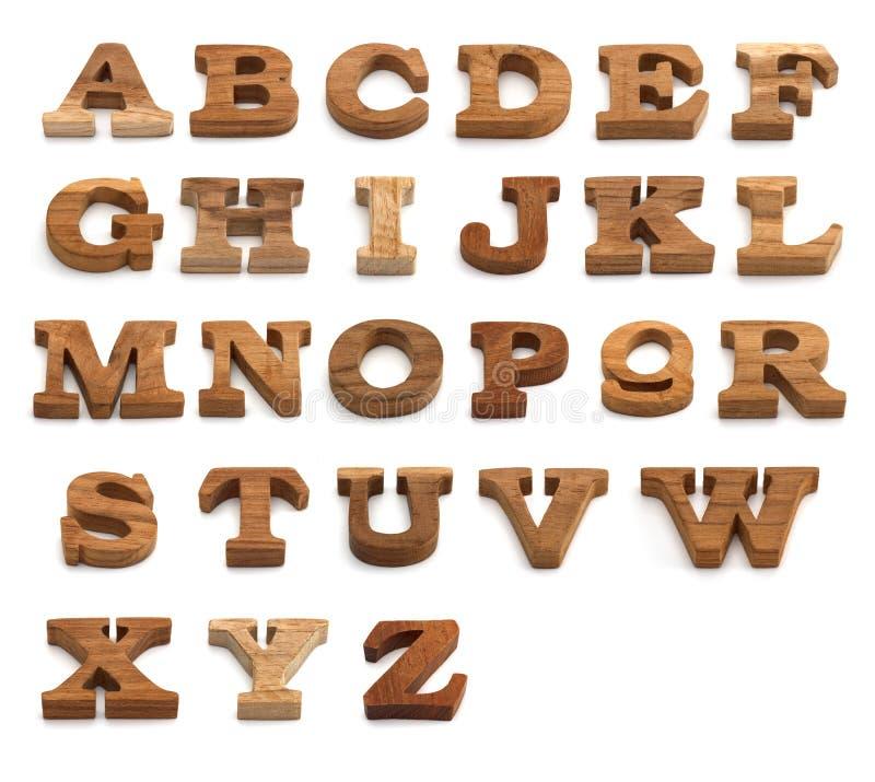 Uppsättning av alfabetet som göras från trä arkivbilder
