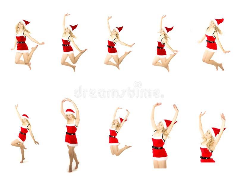 Uppsättning av den lyckliga le kvinnan i röd xmas-dräkt som högt hoppar royaltyfri fotografi