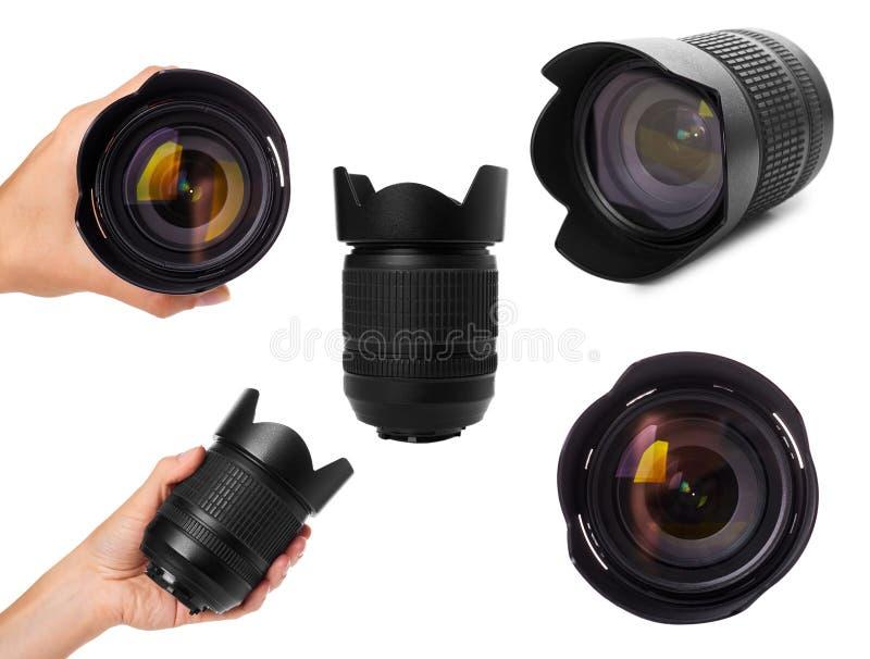 uppsättning av den olika kameralinsen med handen som isoleras på vit bakgrund arkivbild
