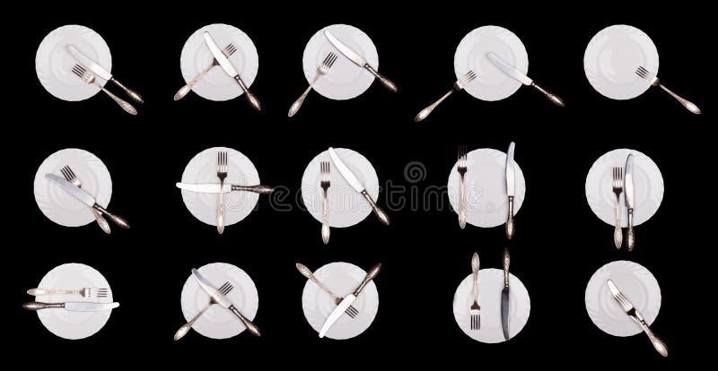 Uppsättning av etiketttecken: platta kniv, gaffel som isoleras på svart royaltyfria foton