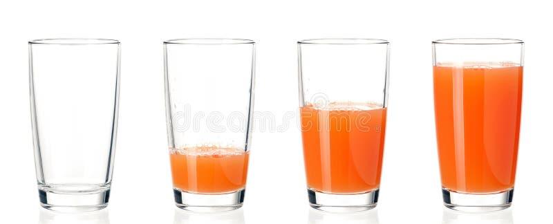 Uppsättning av exponeringsglasfruktsaft royaltyfria bilder
