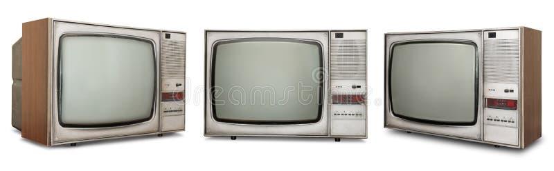 Uppsättning av gamla tv:ar på vit royaltyfri foto
