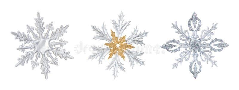 Uppsättning av genomskinliga snöflingor arkivbild