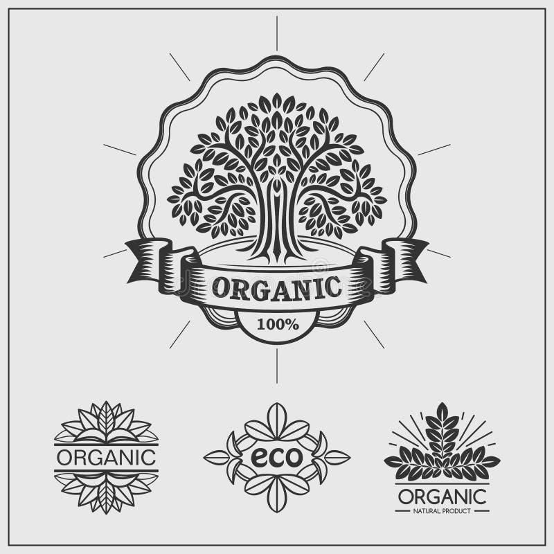 Uppsättning av gräsplanetiketter och emblem för organiskt, eco och bio produkter på svart bakgrund stock illustrationer