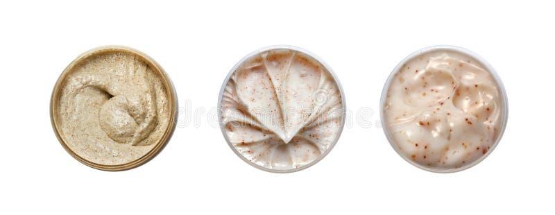 Uppsättning av kräm för 3 olik skönhetsmedel royaltyfri foto