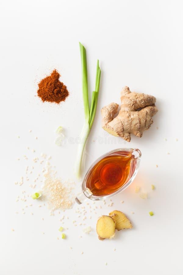 Uppsättning av kryddor för grillfestmarinad på vit bakgrund royaltyfria foton