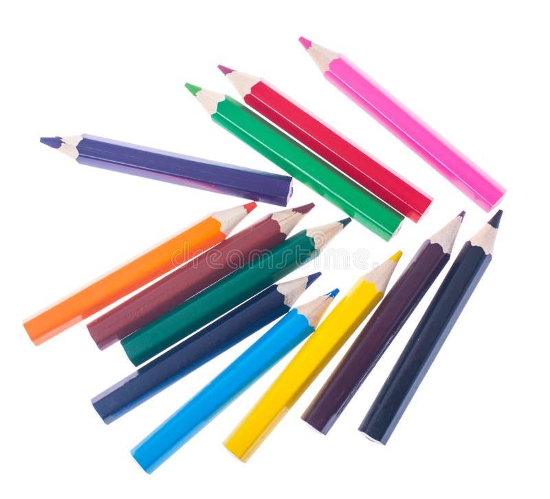 Uppsättning av kulöra blyertspennor på vit bakgrund för professionell eller s fotografering för bildbyråer