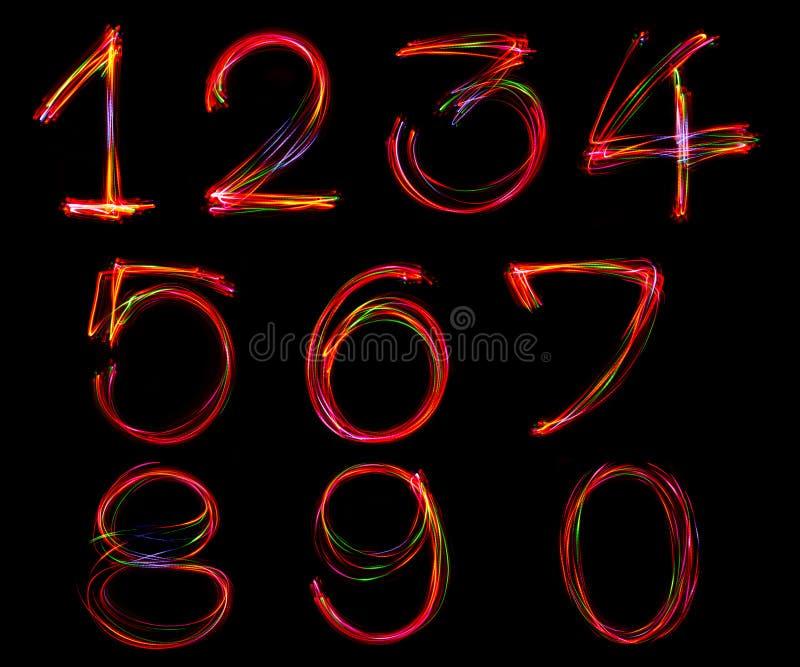 Uppsättning av nummerhandstil från ljus royaltyfria bilder