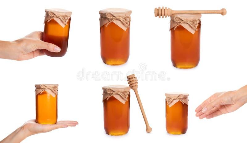 uppsättning av olik ny honung i en glass bunke bakgrund isolerad white Kvinnligt räcka royaltyfri bild