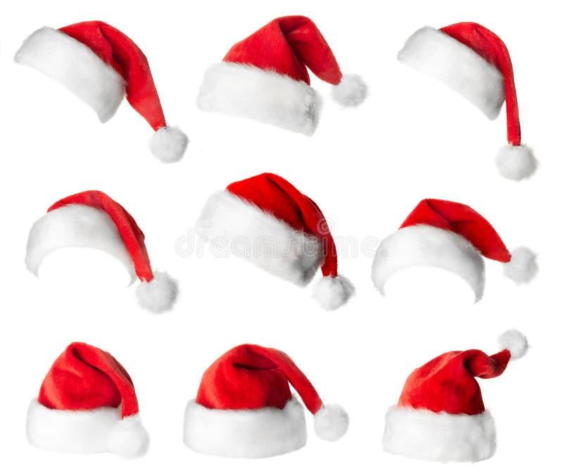 Uppsättning av röda Jultomte hattar arkivfoto