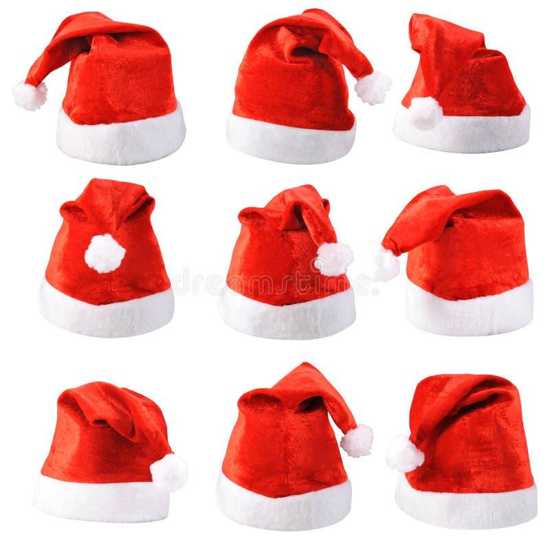Uppsättning av röda Jultomte hattar royaltyfri fotografi