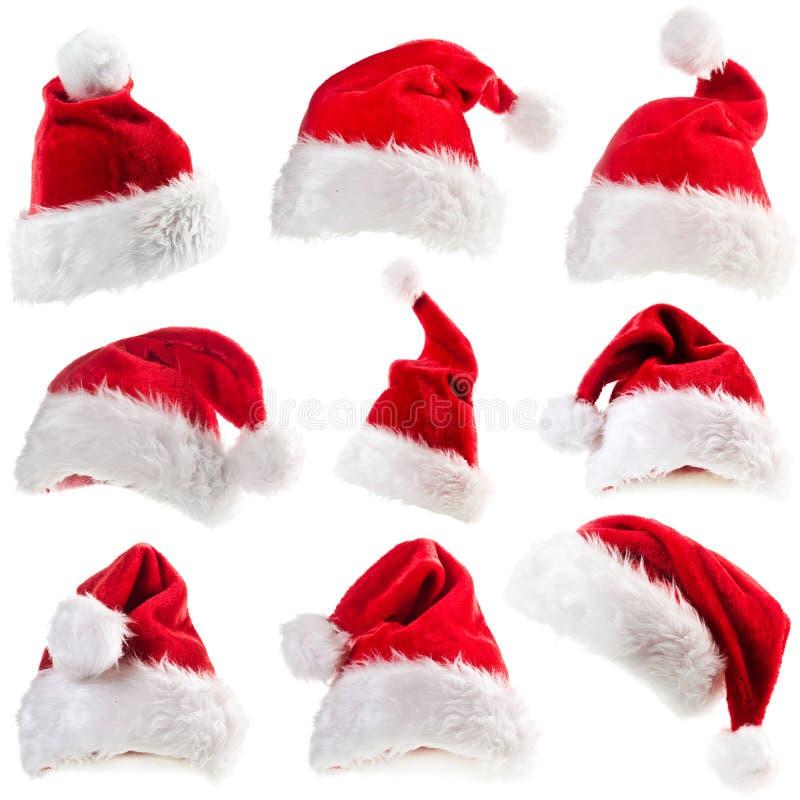 Uppsättning av Santa Claus hattar arkivbild