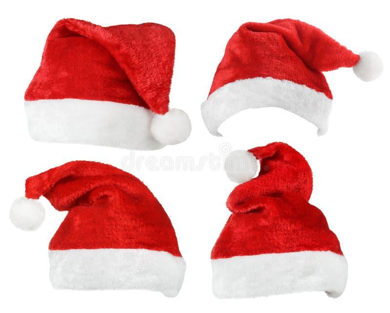 Uppsättning av Santa Claus röda hattar arkivbild