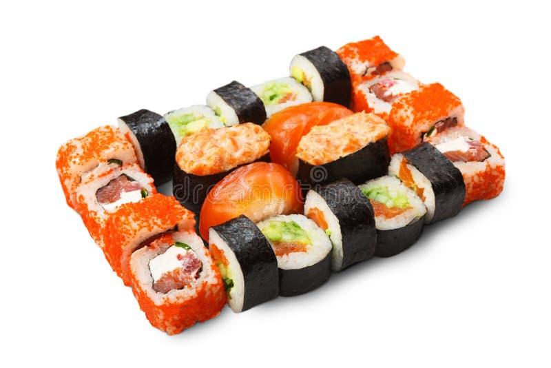 Uppsättning av sushi, maki och rullar som isoleras på vit arkivbilder