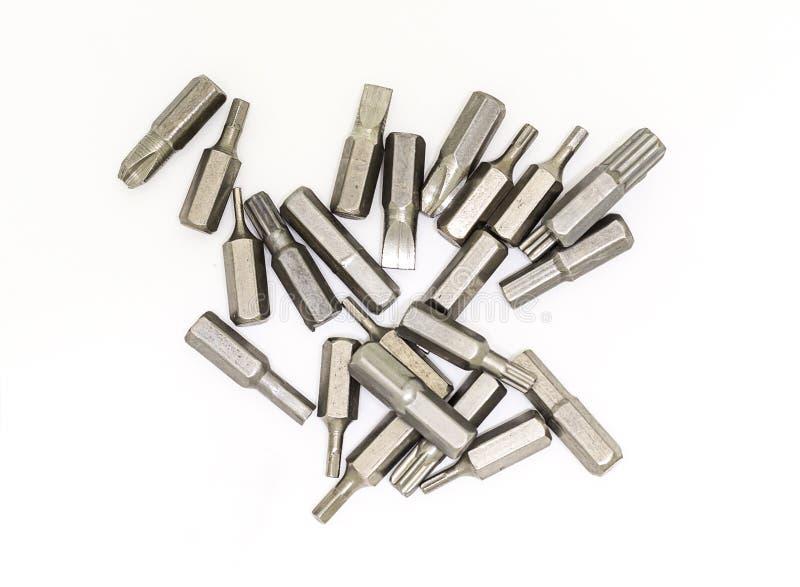Uppsättning av utbytbara bitar av hjälpmedelhuvudskruvmejseln många olika placerat kors för stål bitar royaltyfria bilder