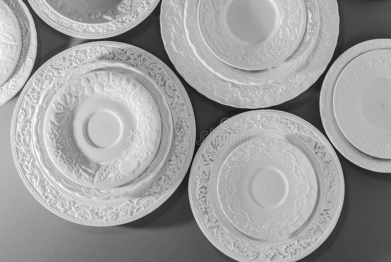 Uppsättning av vita keramiska texturerade plattor royaltyfri foto