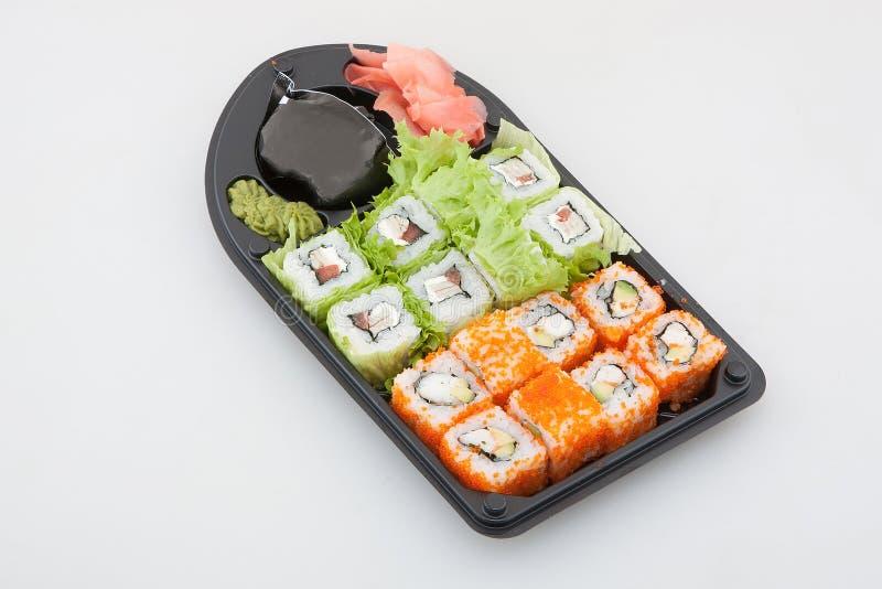 Uppsättning för sushirulle, japansk kokkonst royaltyfri fotografi