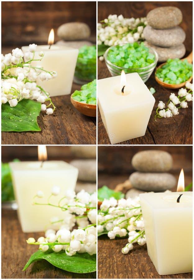 Uppsättningen av brunnsortstilleben med en stearinljus, saltar och liljan av vallen royaltyfria foton