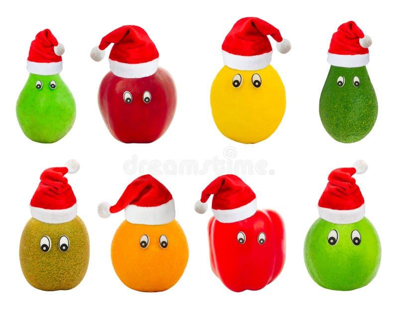 Uppsättningen av frukt med synar i röda hattar av Jultomte royaltyfria bilder
