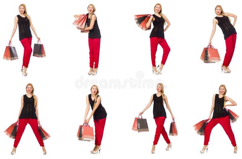 Uppsättningen av kvinnan med shoppingpåsar på vit royaltyfria bilder