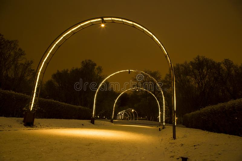 Beautiful winter night view of city parks in old town Uppsala royalty free stock photos