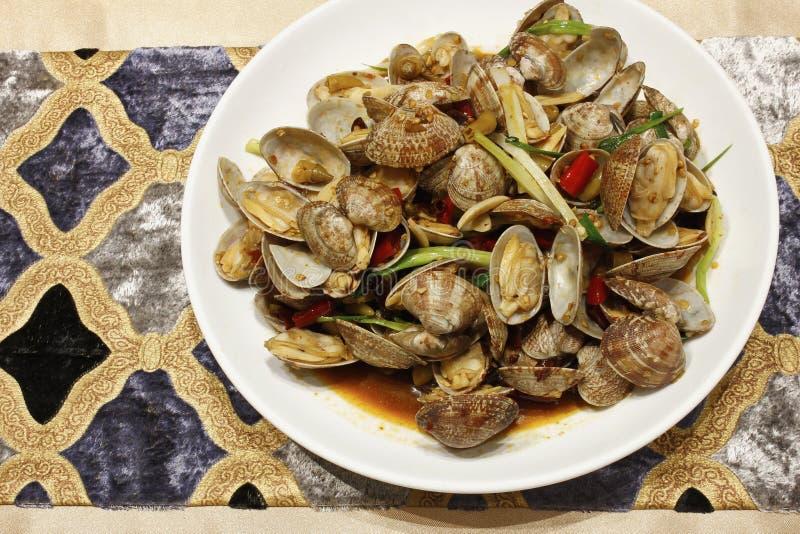 Uppståndelse stekte musslor royaltyfri foto