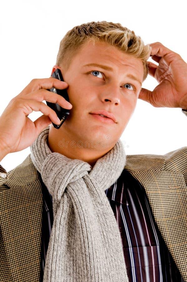 upptagen professionell för felanmälanspersontelefon arkivfoto