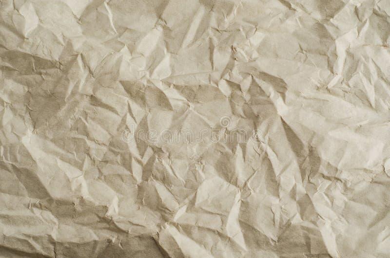 Uppvecklat skrynkligt frilägepapper med veck royaltyfri bild