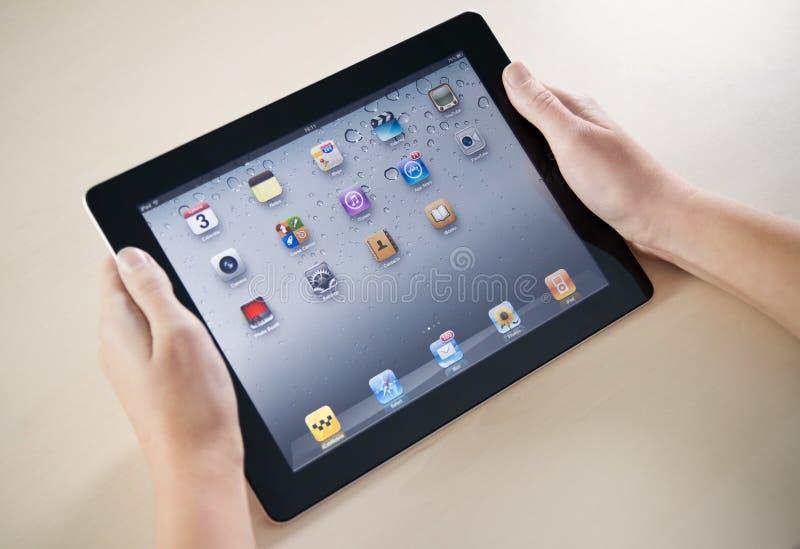 Uppvisning av Apple iPad2 Homepage arkivbild