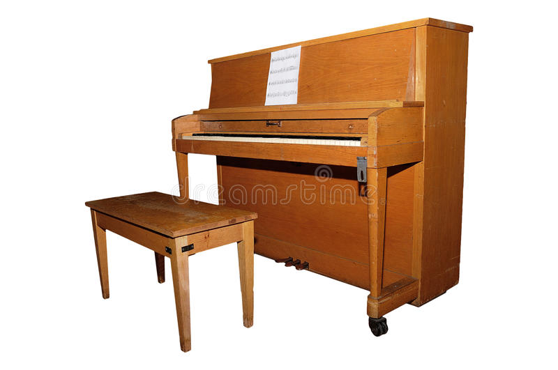 Upright piano. Old upright piano and bench isolated over white background with clipping path stock photography