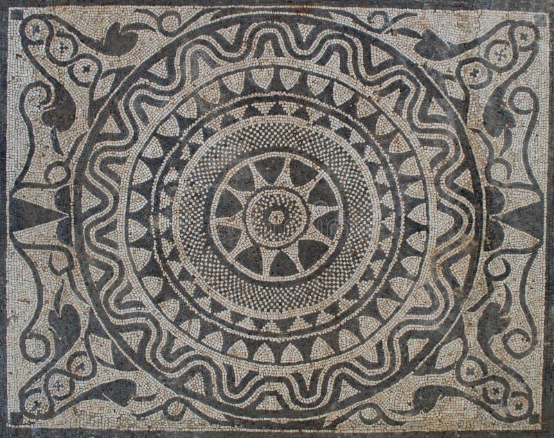 Uprising sun on Mosaic in Roman villa royalty free stock images