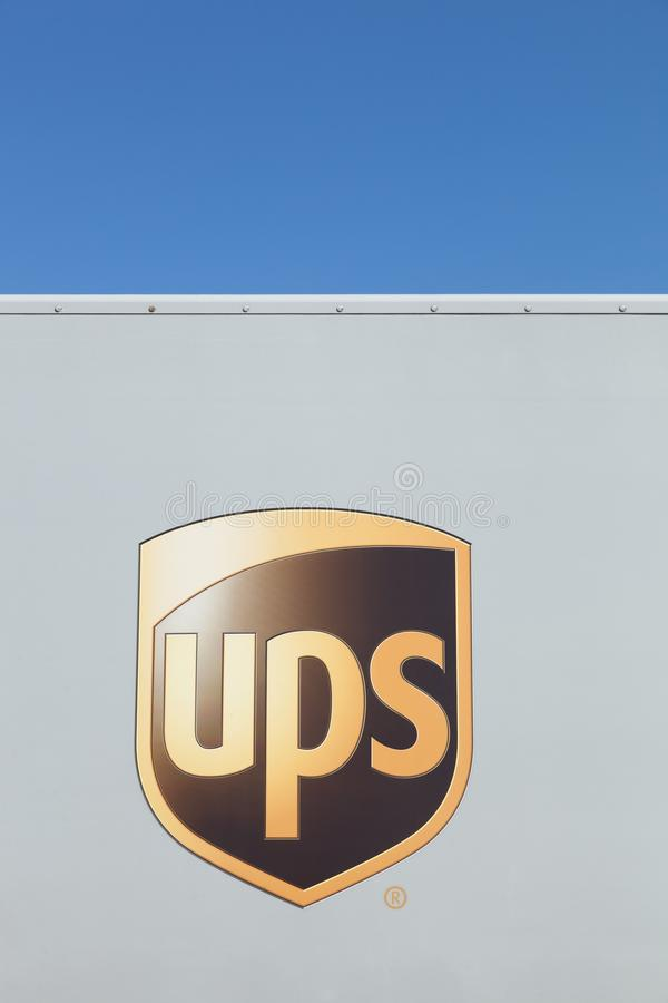 UPS logo on a wall. Aarhus, Denmark - August 9, 2015: UPS logo on a wall. United Parcel Service is the worlds largest package delivery company and a provider of stock image