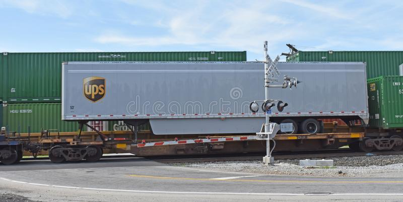 UPS Piggy Back trailer. A UPS piggy back trailer is shown on a flat car on a Norfolk Southern line east of Greenville SC on June 14, 2018. Note the west bound stock photos