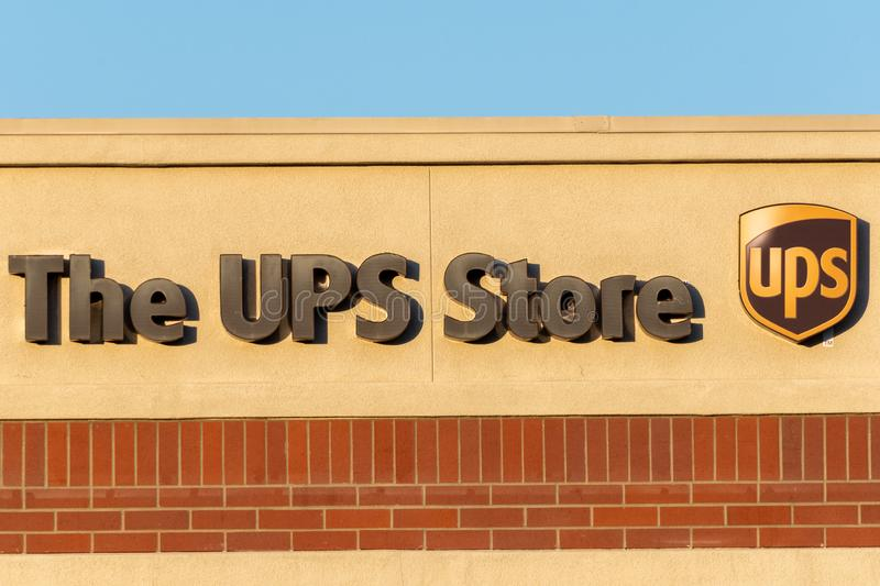 UPS Store sign and logo in a building wall stock image