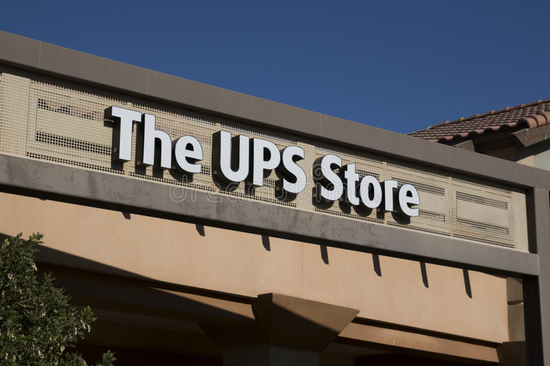 UPS Store Sign. United Parcel Service (UPS) has stores throughout the United States where shippers can package and drop off their packages for shipment royalty free stock image