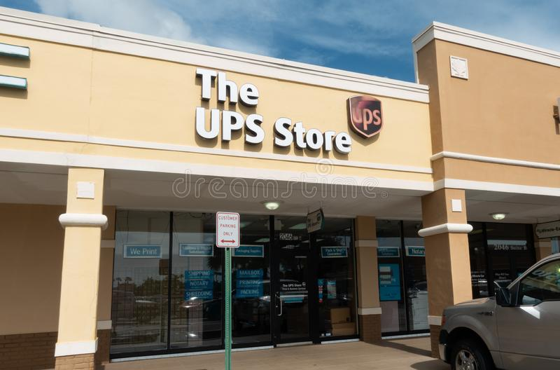 The UPS Store storefront in a shopping center. Vero Beach, FL/USA - 8/2/19 - The UPS Store retail storefront which provides .ServicesPackaging and labeling stock photo