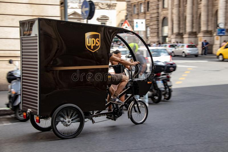 A UPS Tricycle in Rome. A UPS delivery tricycle on the streets of Rome, Italy royalty free stock photos