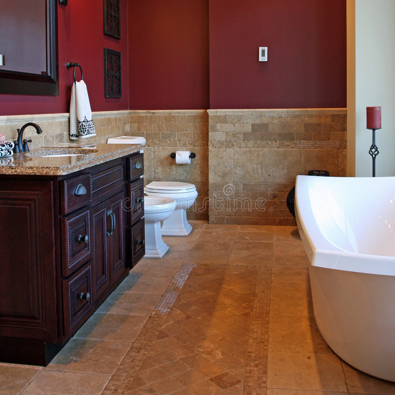 Upscale Bathroom. An elegant bathroom with stone tile flooring and granite countertops royalty free stock photography
