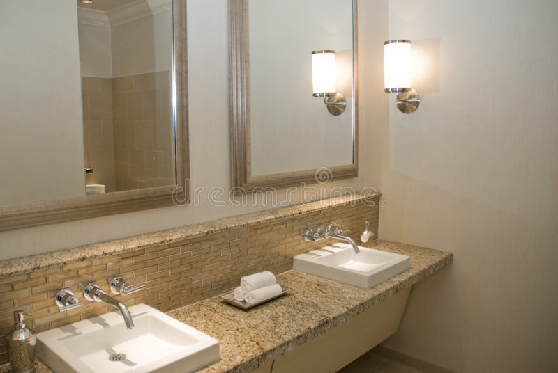 Upscale Bathroom Vanity. With two sinks and mirrors royalty free stock image