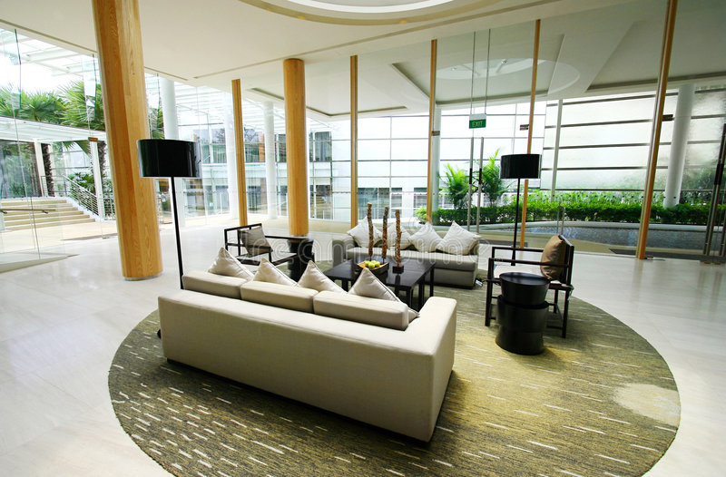 Upscale hotel resort lobby interiors. An image showing the beautiful interior design of the entrance reception lobby of a new upscale five star resort hotel. Use stock photo